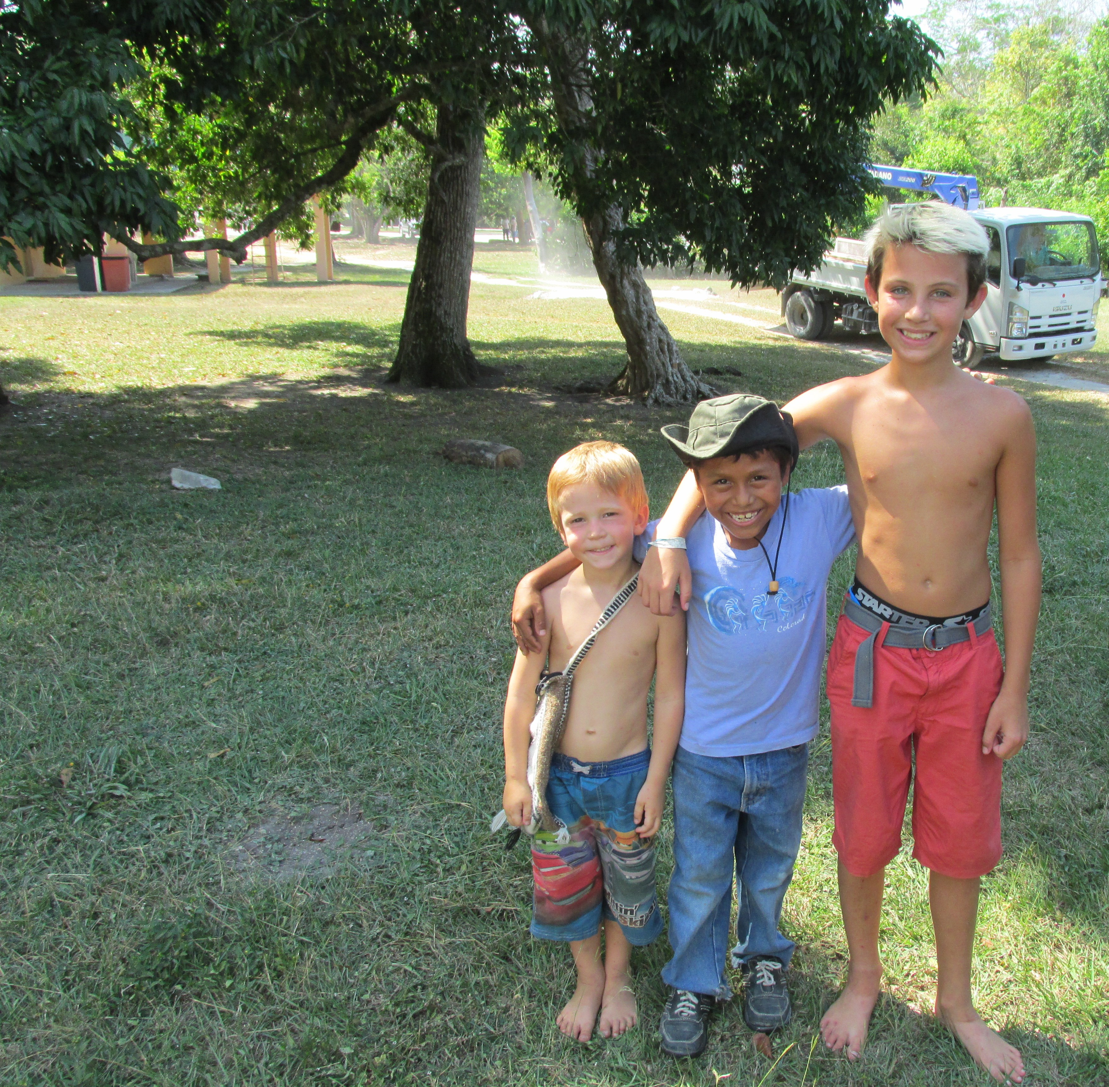 Castle (4), cute Guatemalan boy (9), Noah (12) at Tikal.  This boys mama made yummy banana bread - we bought about 12 mini loaves between our two families!